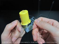 09:膠片去到電子爉燭的最底部就變得很穩固。