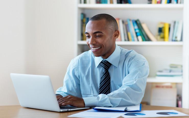 Fiduciary-Financial-Advisor-Sitting-At-Desk