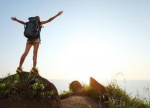 Backpacker reaching summit