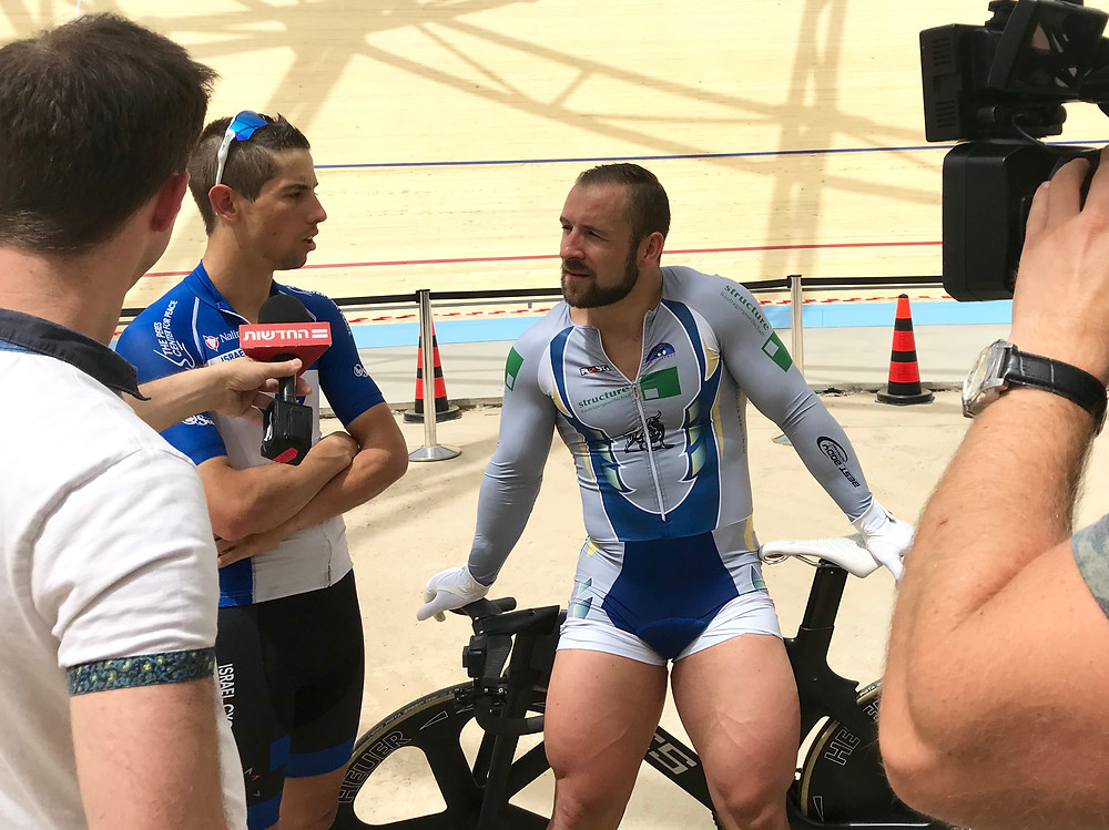 Journalists interview German track cyclist Robert Förstemann and Israel Cycling Academy's Roy Goldstein at the Velodrome in Tel Aviv, May 1, 2018. Photo: Viva Sarah Press