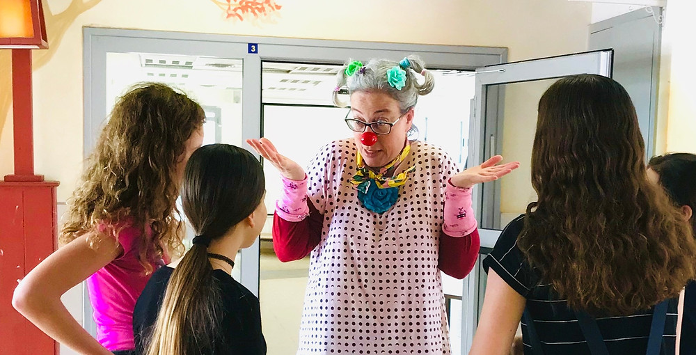 School clown Oshi chats with pupils. 2019.