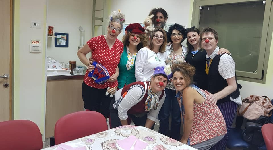 Medical clowning in Ashkelon, July 2018. That's me in red! Talia Safra, in the front row without the red nose, is our teacher. Photo by Eti Zilberberg