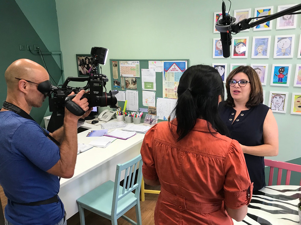 Miri Nitzani, principal of the Shimon Peres primary school in Rosh Haayin being interviewed for Childhood Elsewhere. Photo: VSP