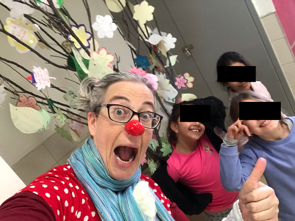 Oshi the clown with pupils at the Peres elementary school in Rosh Haayin, Israel. 2019.