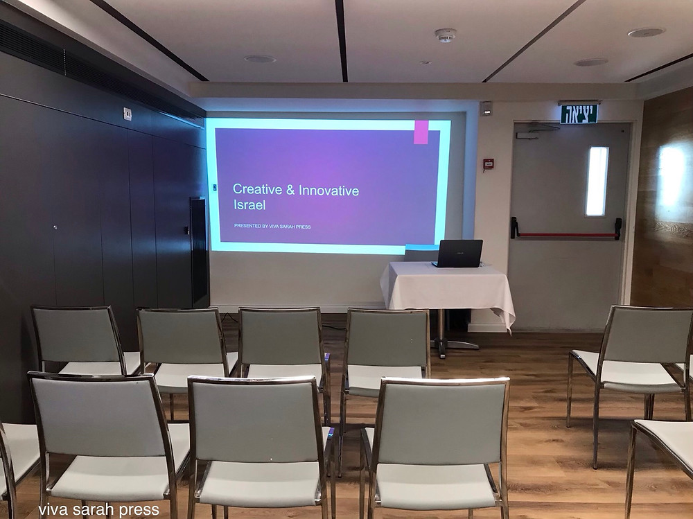 "Room is set up for my talk on 'Creative & Innovative Israel.' The ""exit"" sign is rather apt... Israel is famous for its high-tech exits. July 3, 2019"