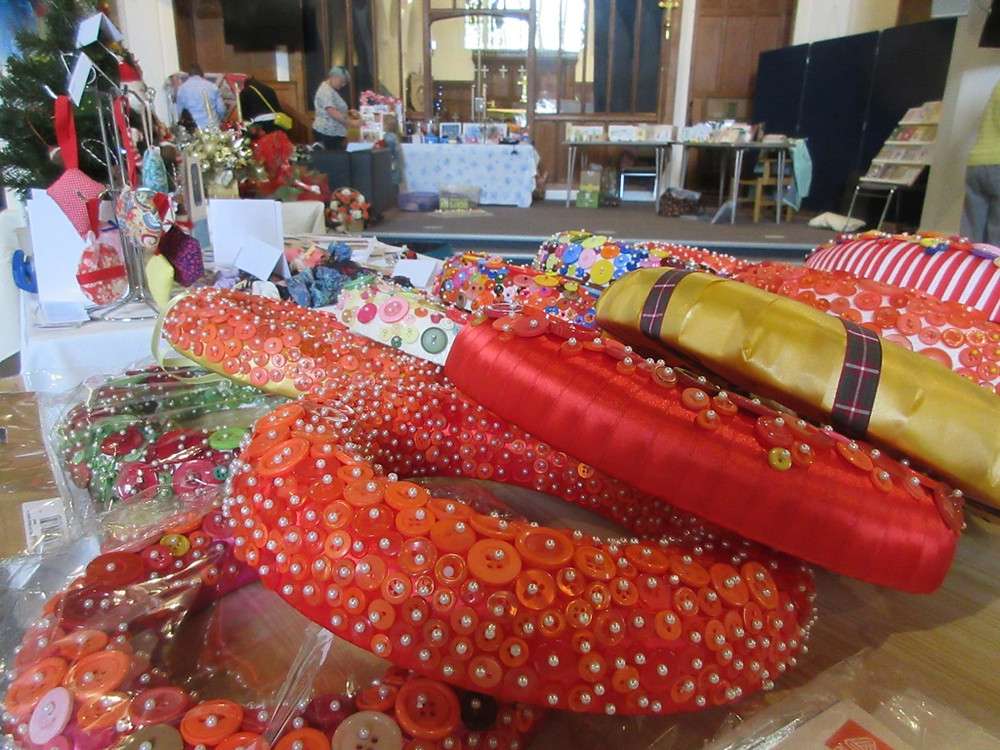 Stalls at the Craftaway selling button wreaths from Made In Molesey craft club local crafters and makers in aid of Mind