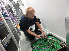 IT cleaning team in action. Cleaning server room floor voids