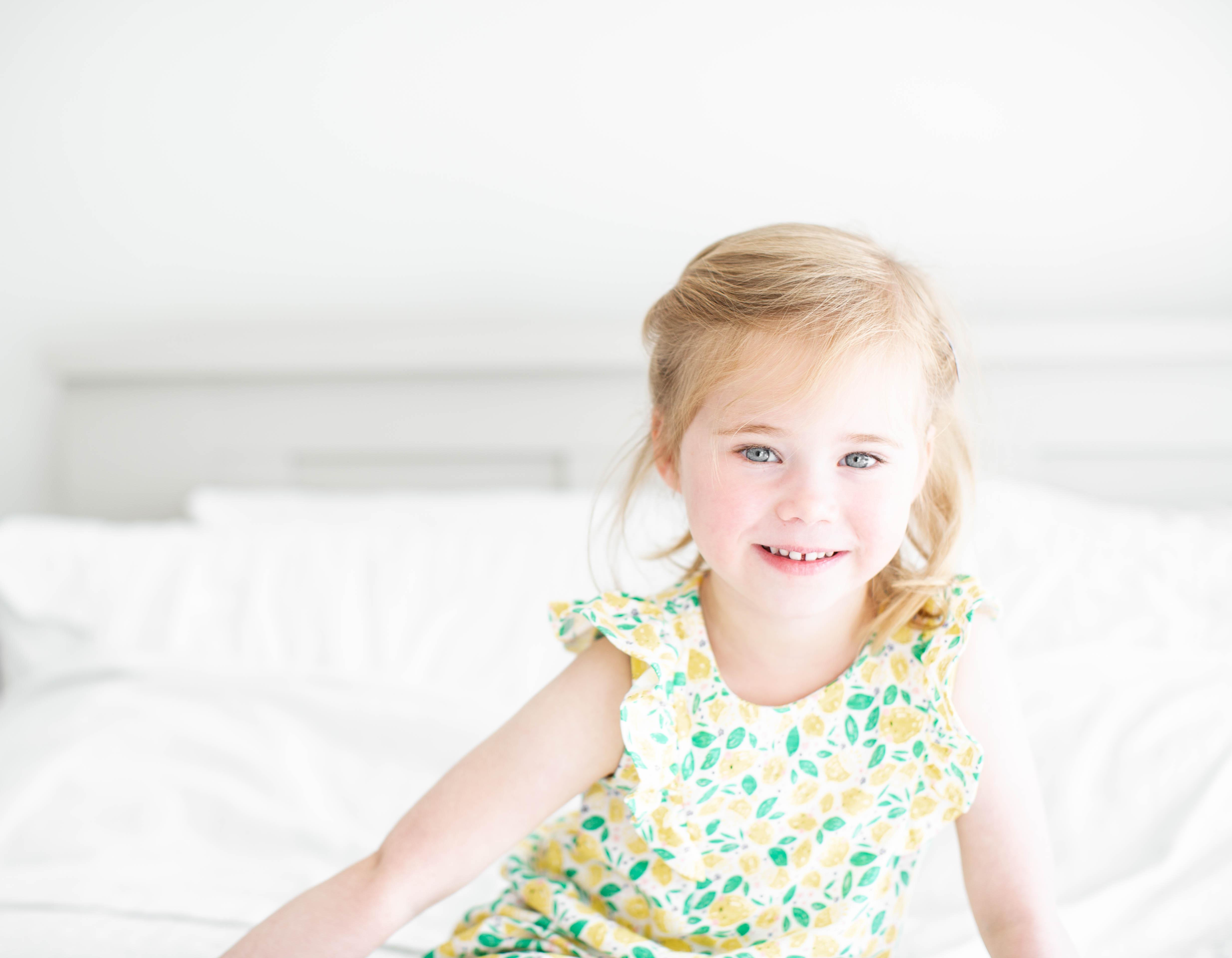 A girl smiling at the camera.