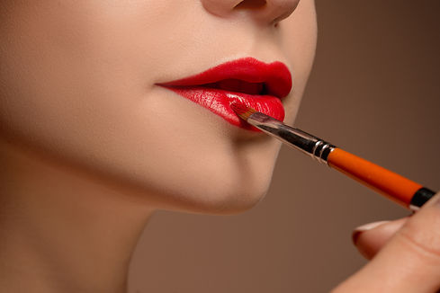 beautiful-female-lips-with-make-up-brush