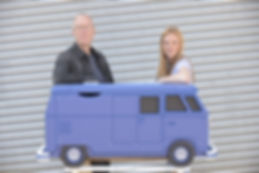 Mark Turner and Llinos Mair Pritchard founders and owners of Fun Furniture Collection on a photoshot with the Stoke Sentinal with a picture of their Camper Van Toy Chest. Makersof handmade kids theme beds
