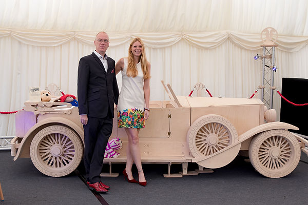 Picture of Mark Turner and Llinos Mair Pritchard owners and founders of Fun Furnitre Collection at the RREC Diamond Jubilee event in Burghley House 2017 showing their Rolls- Royce 1929 Ascot Phantom kids theme single bed