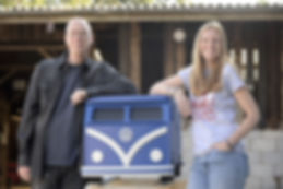 Mark Turner and Llinos Mair Pritchard founders and owners of Fun Furniture Collection on a photoshot with the Stoke Sentinal with a picture of their Camper Van Toy Chest