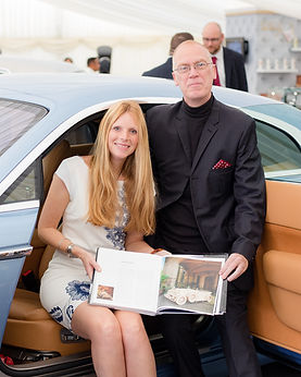 Picture of Mark Turner and Llinos Mair Pritchard owners and founders of Fun Furnitre Collection sat in Rolls-Royce car at the RREC Diamond Jubilee event in 2017 showing their Rolls- Royce 1929 Ascot Phantom theme bed in the book