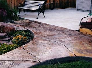 concrete patio with decorative concrete border
