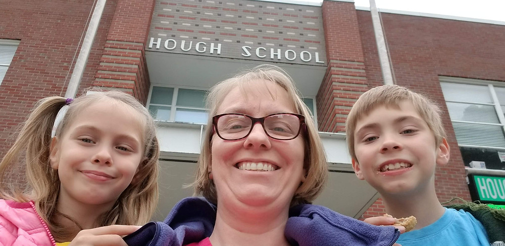 Lisa with her son and daughter in front of Hough.