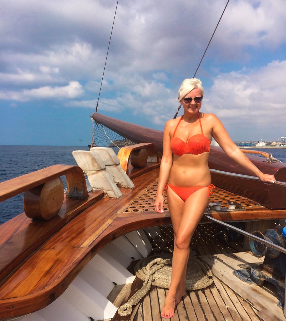 Girl onboard sailing boat