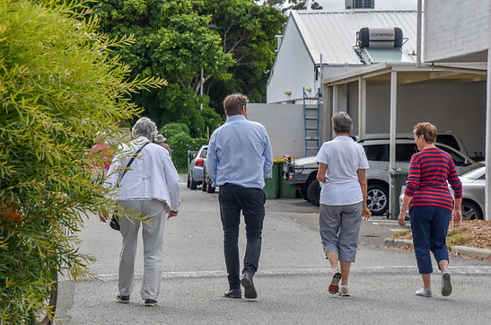 Physio with clients walking