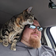 Chris and foster kitty, Hazel.