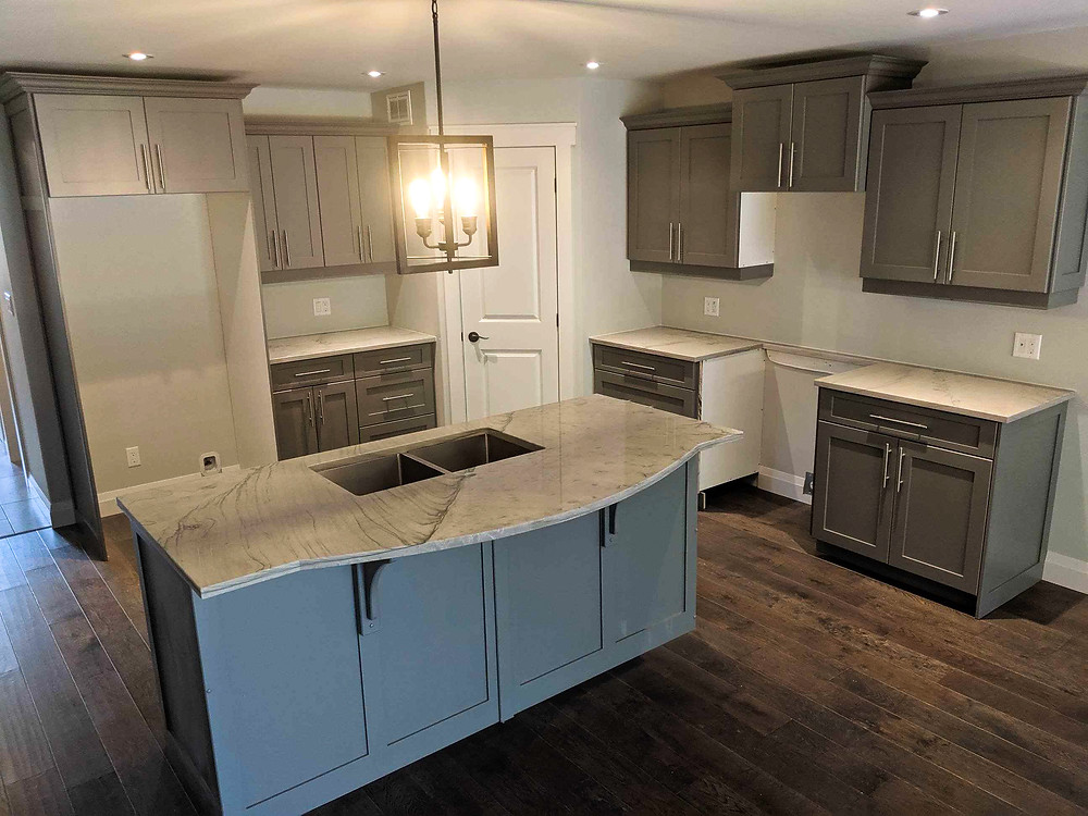 Renovated kitchen in neutral tones made with be spacious and