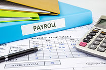 PAYROLL word on blue binder place on wee