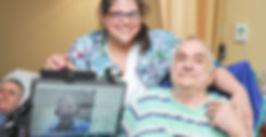 Telemedicine doctor with smiling nurse and nursing home resident