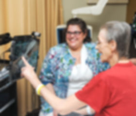 Nursing home patient interacts with telemedicine doctor