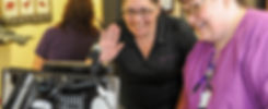 Nursing staff waves hello to doctor via telemedicine cart