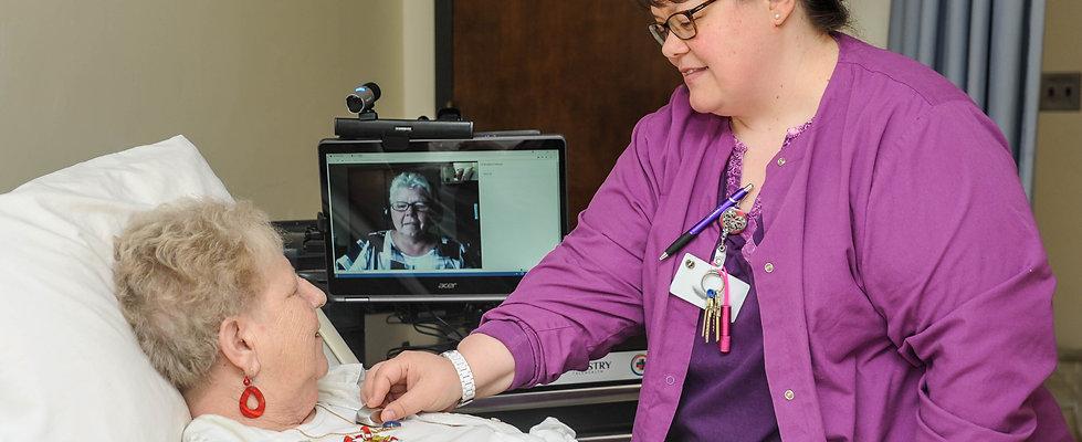 Nurse Practitioner visits resident through telemedicine