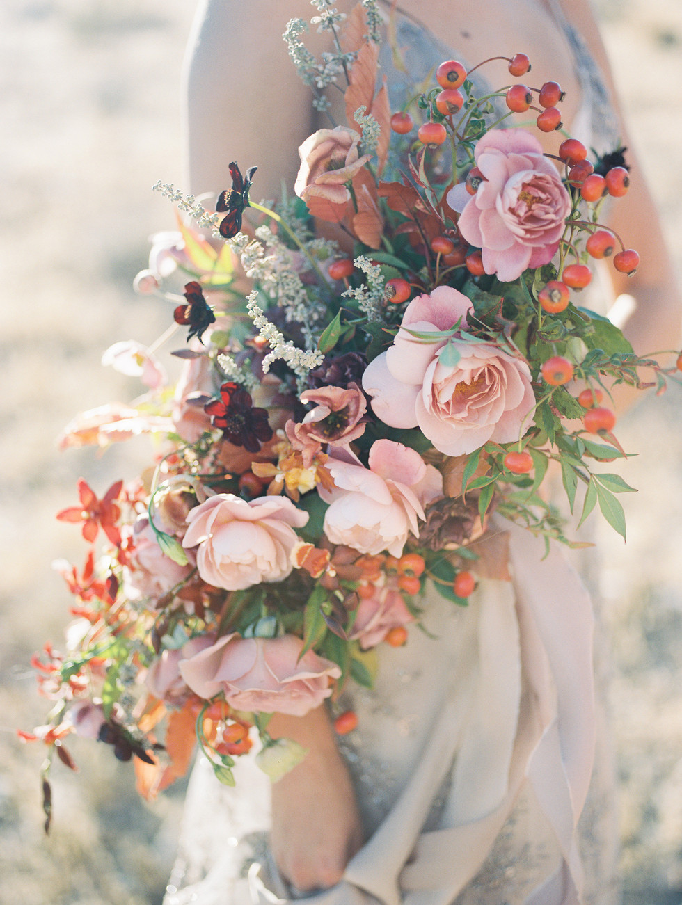 Autumnal bridal bouquet with Distant Drum roses, Koko Loko roses, orchids, lisianthus, french lavender and rose hips. Photo: Shannon Elizabeth