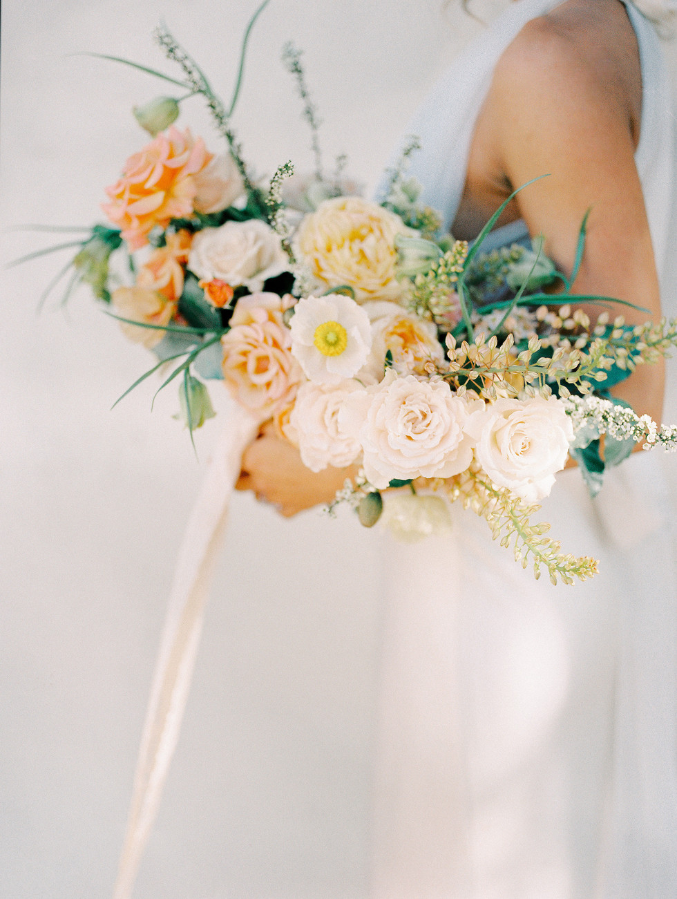 Spring wedding bouquet featuring garden roses, poppies, and fritillaria. Photo: Shannon Elizabeth