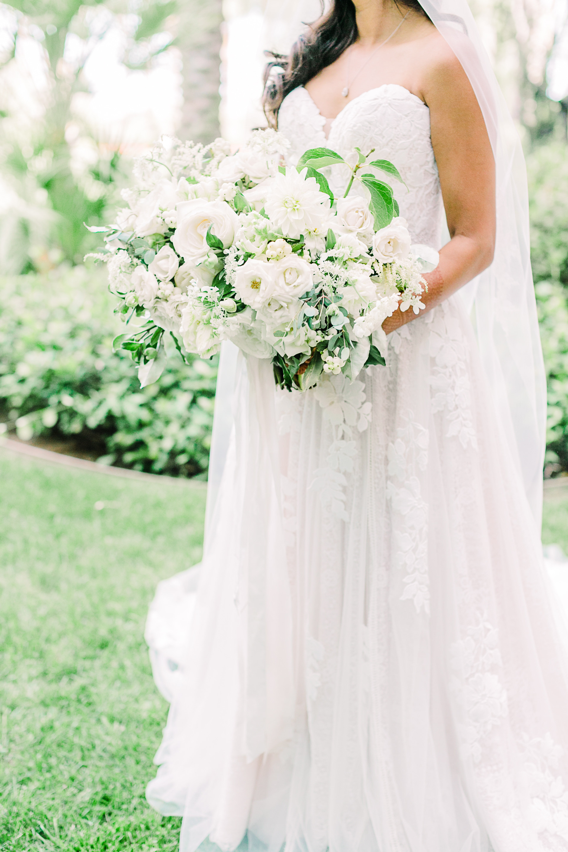 Garden-style bridal bouquet with roses, dahlias, berries, and hellebore. Photo: Kristen Joy