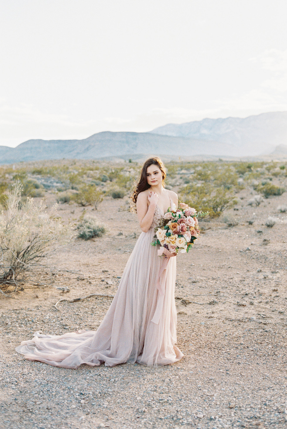 mauve, blush, and ivory bridal bouquet, tied with silk ribbons. Photo: Ryann Lindsay