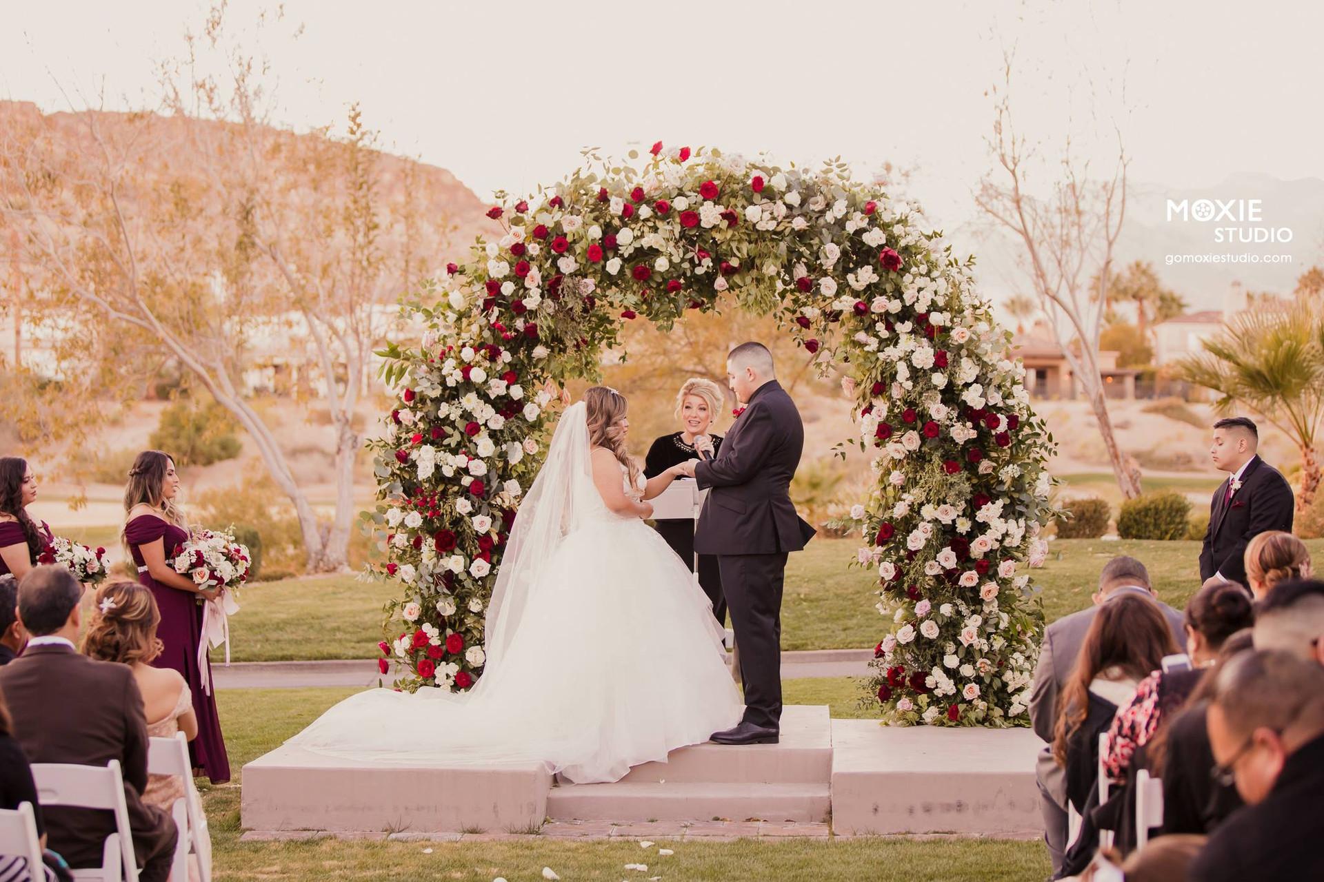 Burgundy and bush wedding ceremony at Red Rock Country Club, Las Vegas, NV. Photo: Moxie Studio