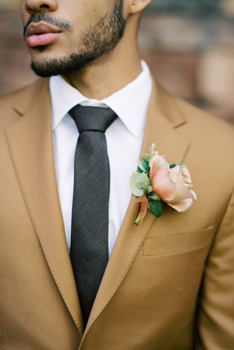Honey-colored rose boutonniere. Photo: Kristen Kay