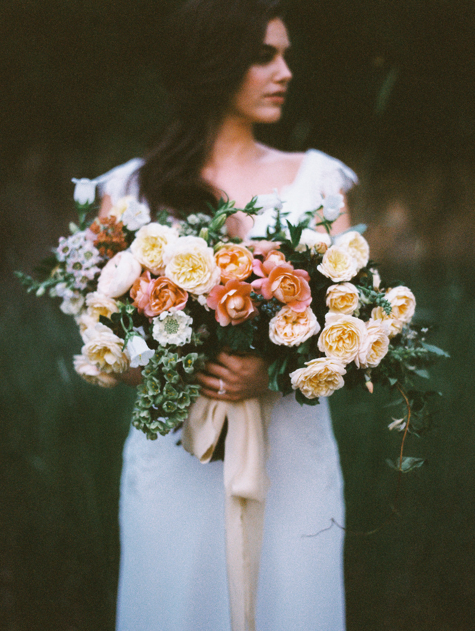 Moody peach and ivory bridal bouquet with garden roses, allium, fritillaria, campanula and lace flower. Photo: Shannon Elizabeth