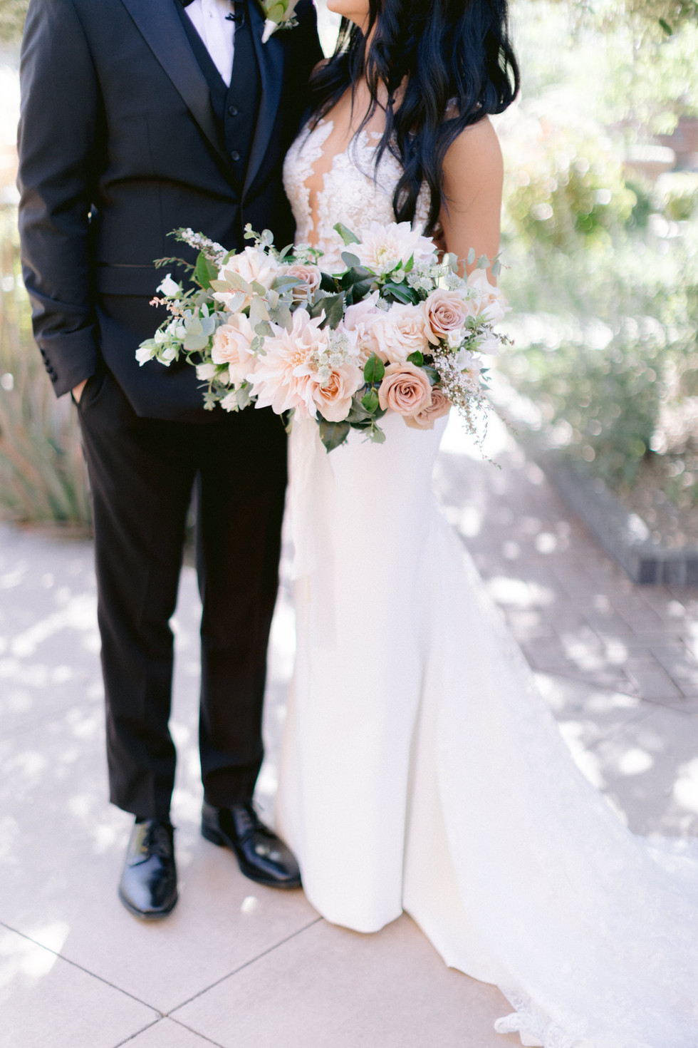 Dahlias, roses, and campanula in shades of blush and dusty rose, tied with long silk ribbons. Photo: Susie and Will