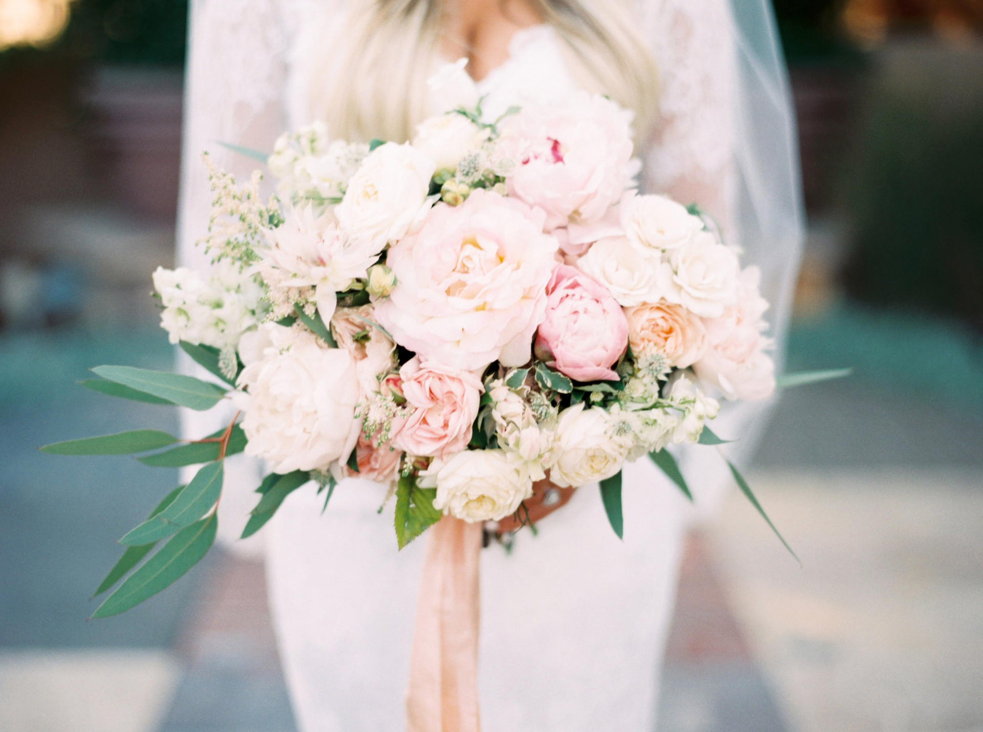 Classic blush and ivory bridal bouquet with peonies and roses. Photo: Mary Claire
