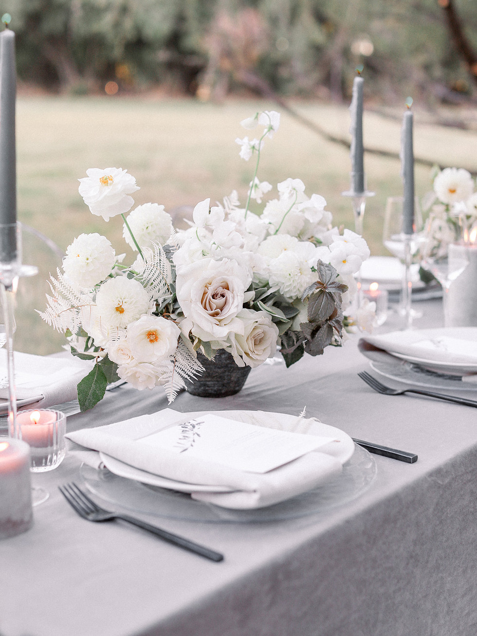 Centerpiece with white dahlias, pansies, sweet pea and Earl Grey roses. Photo: Sarah Brooke