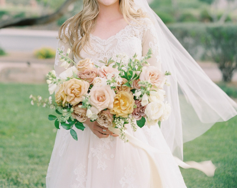 Bridal bouquet with roses, lilac, foxglove, and lace flower in shades of mustard, dusty rose, blush, and ivory. Photo: Lucy Munoz