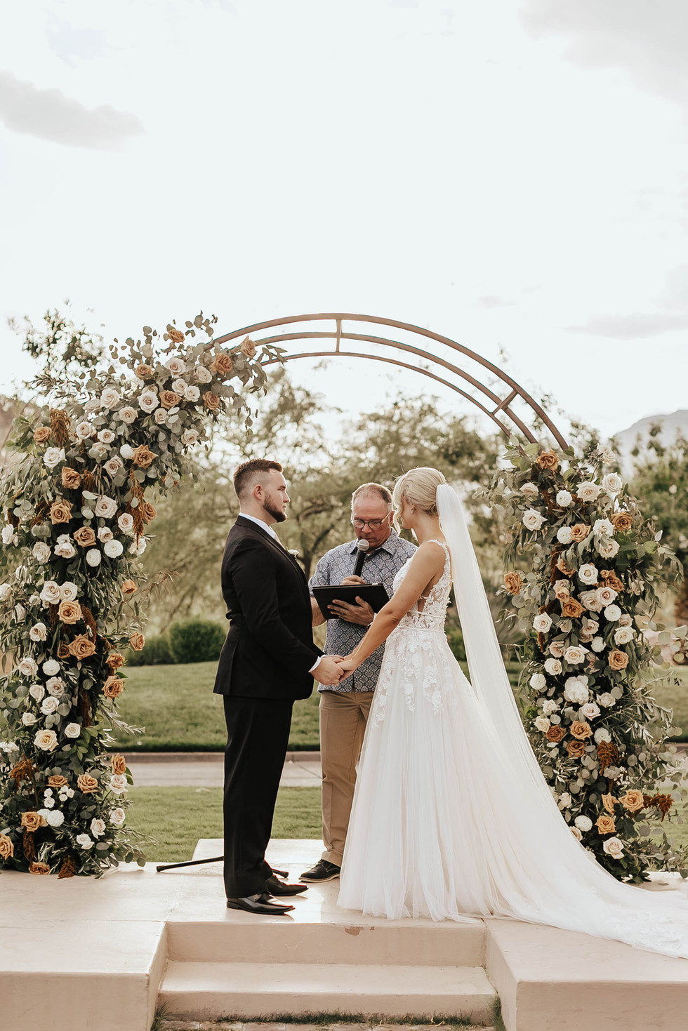 Toffee and dusty blush wedding arch. Photo: Chelsea Kissam