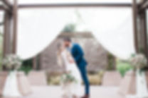 Wedding arch with Flowers and Fabric