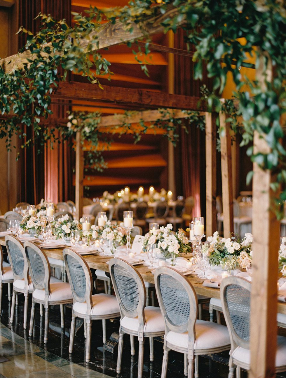 White, ivory and champagne wedding reception. Photo: Gaby Jeter