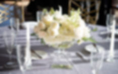 Low Wedding Centerpiece With White Roses, Hydrangea and Lilac in Clear Glass Compote Vase
