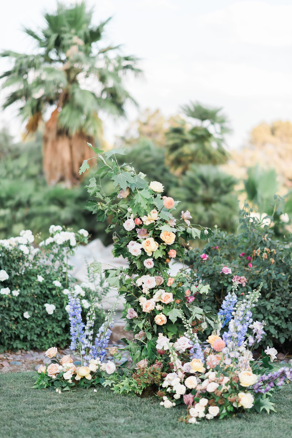 Deconstructed garden arch with roses, delphinium, foxglove, and dahlias. Photo: Jodi Anne