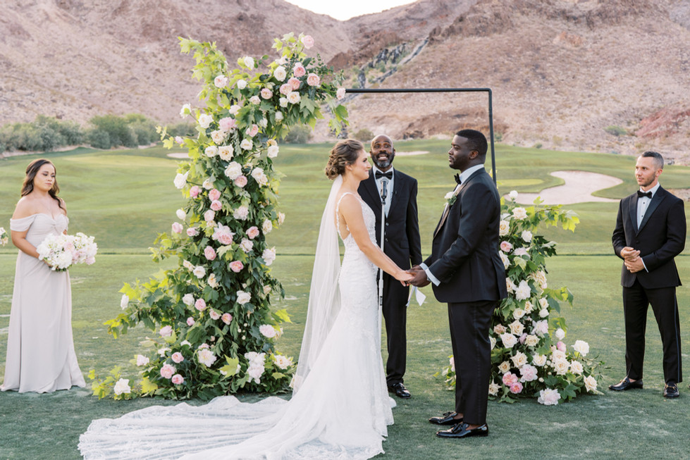 Asymmetrical wedding arch with blush and white roses and lush maple foliage. Photo: Gaby Jeter