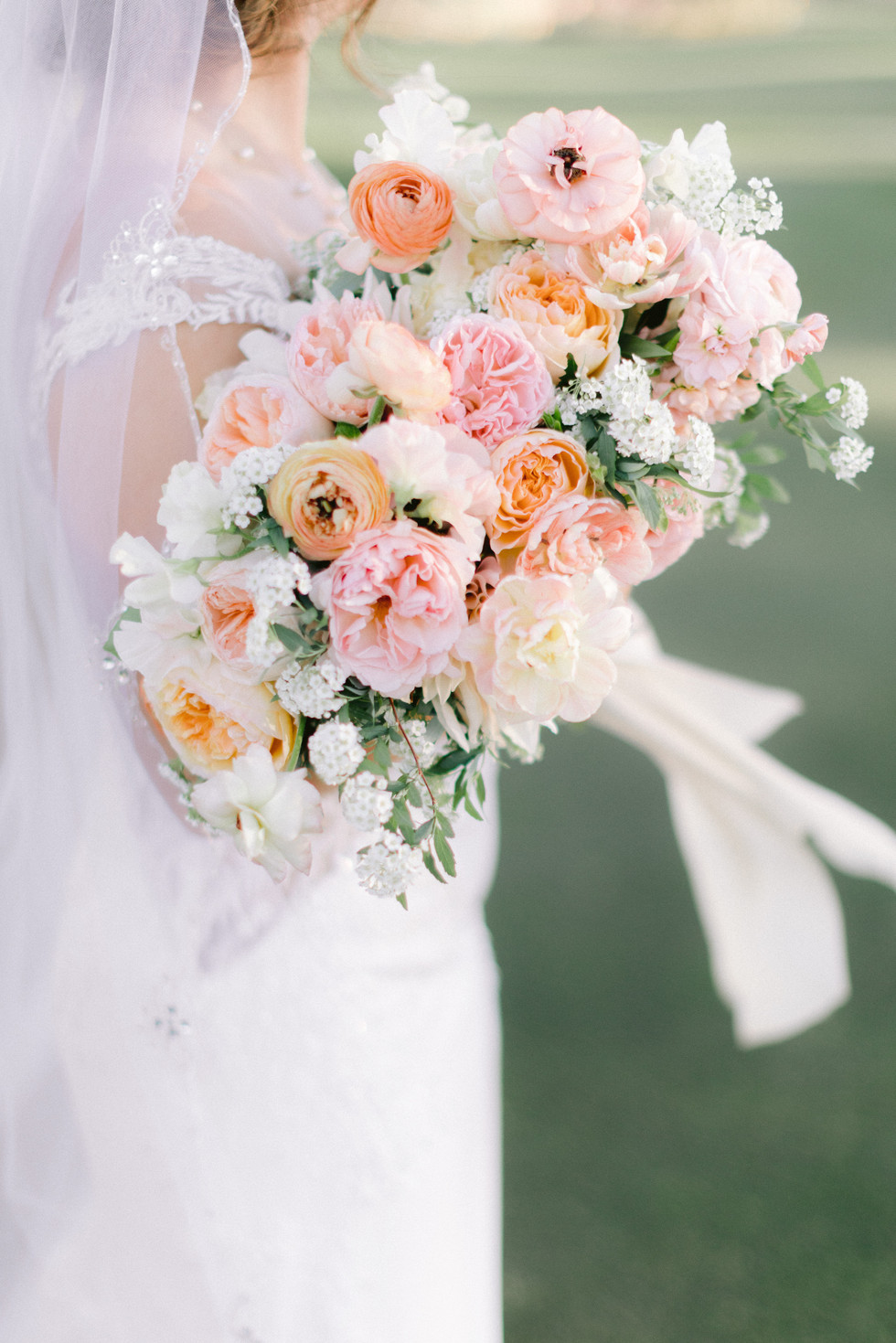 Spring bouquet with garden roses, ranunculus, and sweet pea, in shades of peach and pink. Photo: Susie and Will