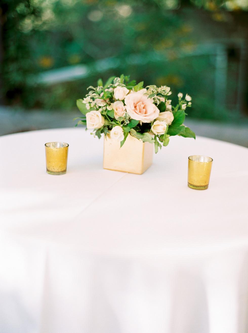Blush and ivory floral arrangement for cocktail table. Photo: Shannon Elizabeth