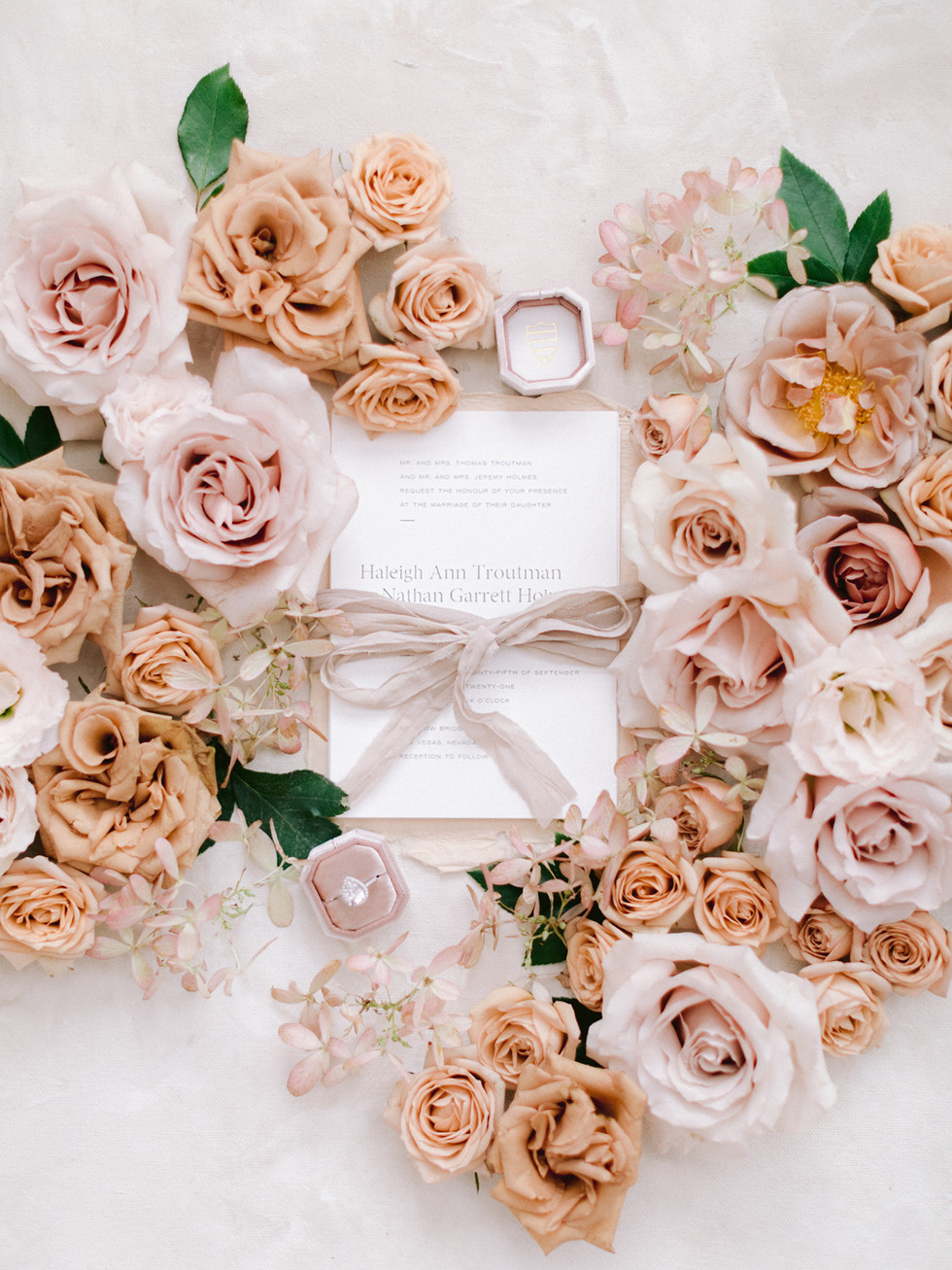 Toffee and blush styling blooms for wedding invitations. Photo: Susie and Will