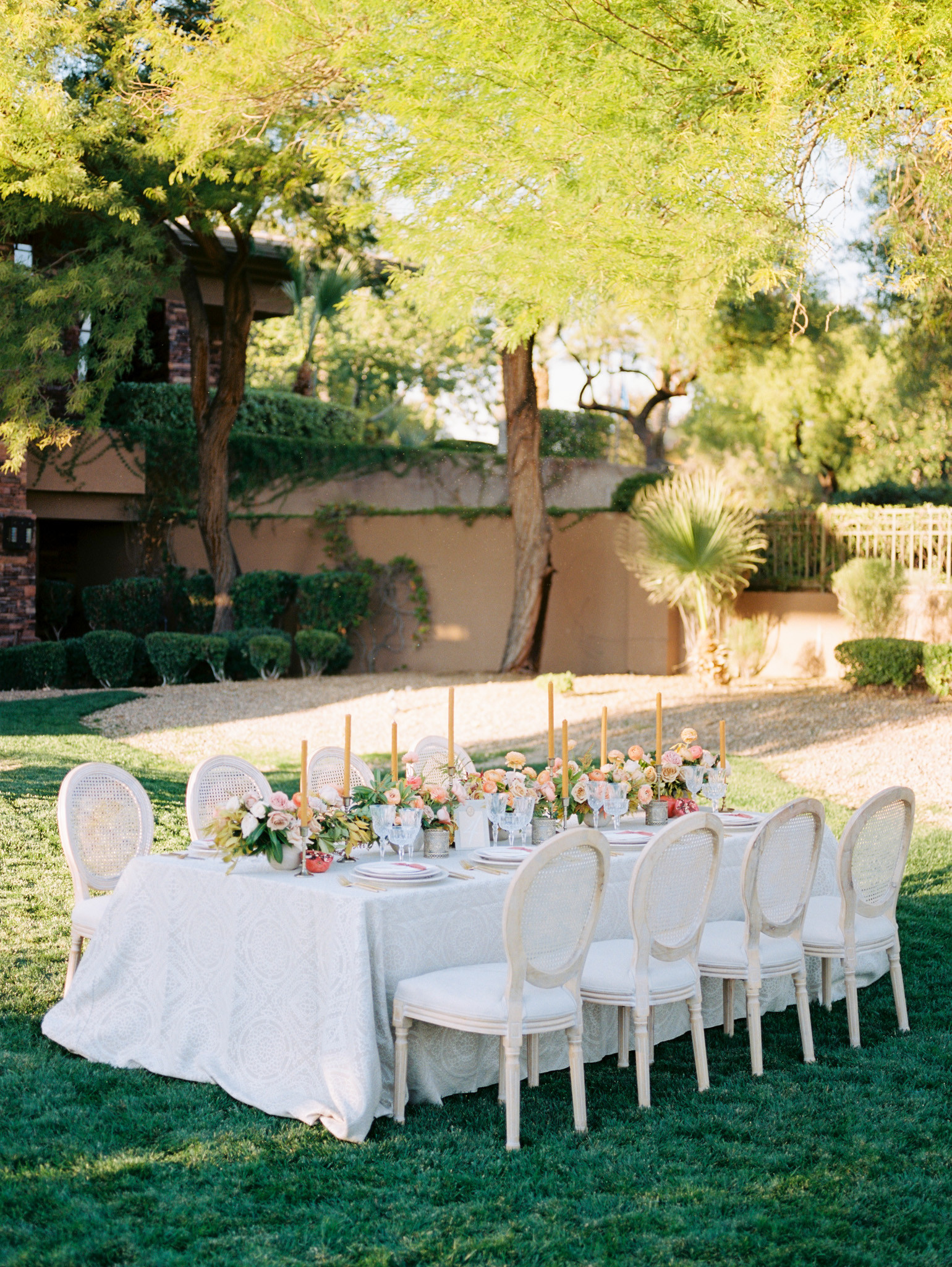INTIMATE DINNER SETTING IN SHADES OF MUSTARD, CORAL, AND TAUPE. PHOTO: KRISTEN KAY
