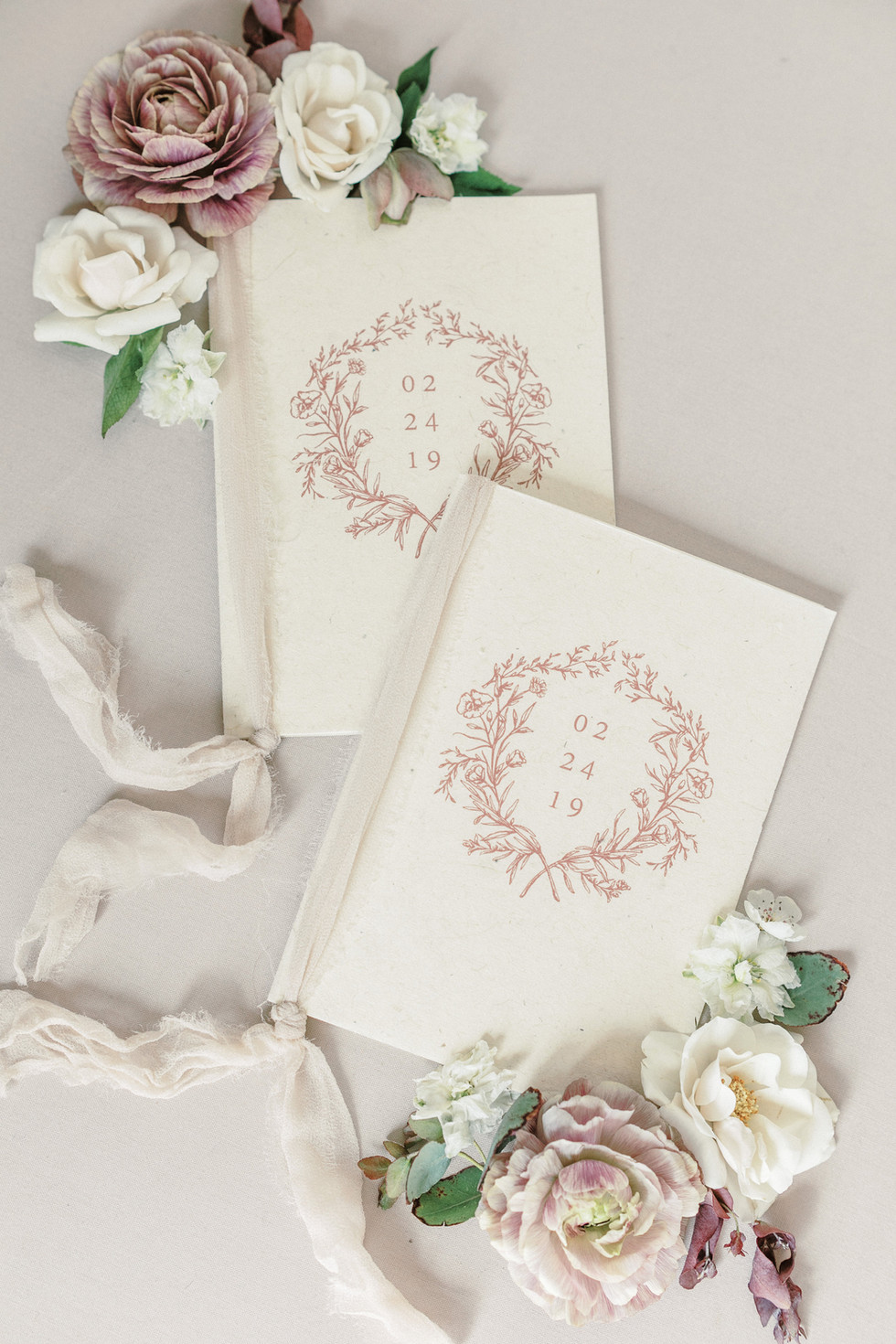 Mauve and ivory styling blooms for vow books. Photo: Ryan Lindsey